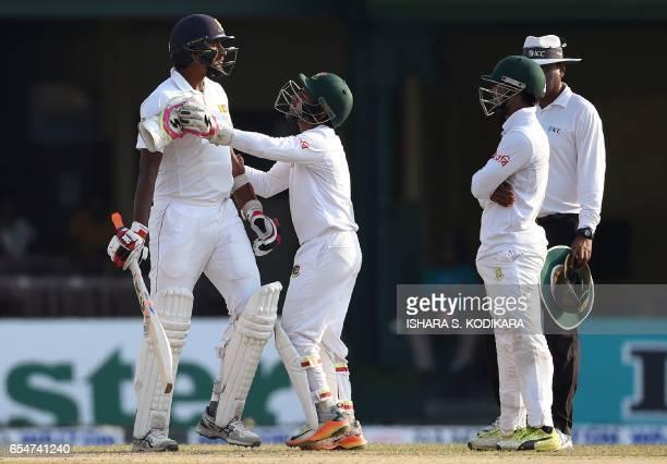 Sri Lankan cricketer Suranga Lakmal exchanges words with Bangladesh fielder Sabbir Rahman as Bangladesh captain Mushfiqur Rahim intervenes during the...