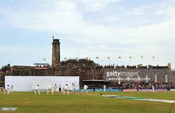 Sri Lankan cricketer Thilan Samaraweera bats in front of the 16th Century Dutch fort overlooking the pitch during the third day of the first Test...