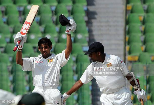 Sri Lankan cricketer Thilan Samaraweera congratulates teammate Tillakaratne Dilshan after scoring a century during the second day of the second and...