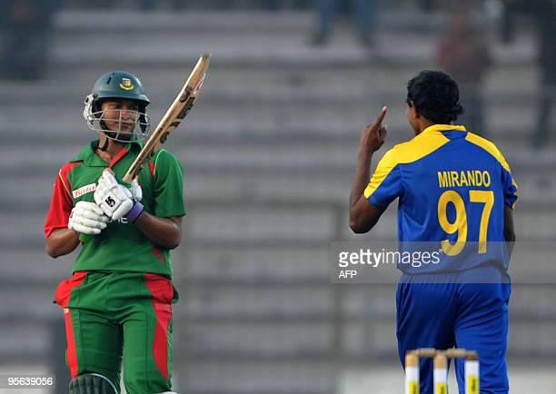 Sri Lankan cricketer Thilan Thushara Mirando gestures as the Bangladesh cricket team captain Shakib Al Hasan looks on during the TriNation tournament...