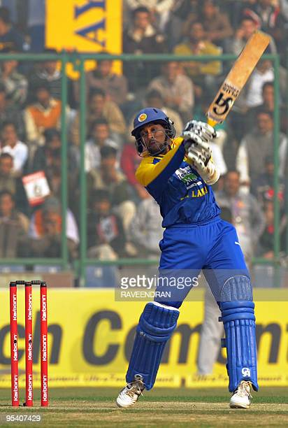 Sri Lankan cricketer Thilan Thushara plays a stroke during the fifth and final One Day International cricket match between India and Sri Lanka at The...
