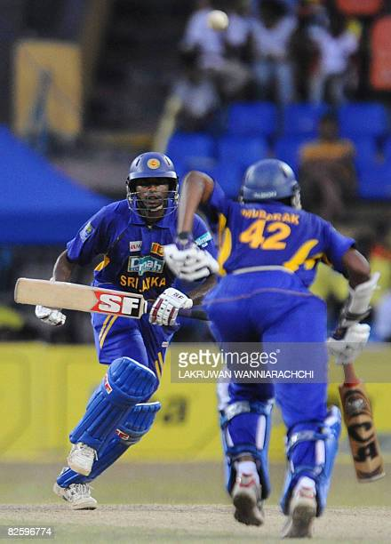 Sri Lankan cricketer Thilina Thushara Mirando and teammate Jehan Mubarak run between the wickets during the fifth and final One Day International...