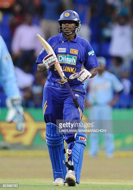 Sri Lankan cricketer Thilina Thushara Mirando celebrates after scoring a halfcentury during the fifth and final One Day International match between...