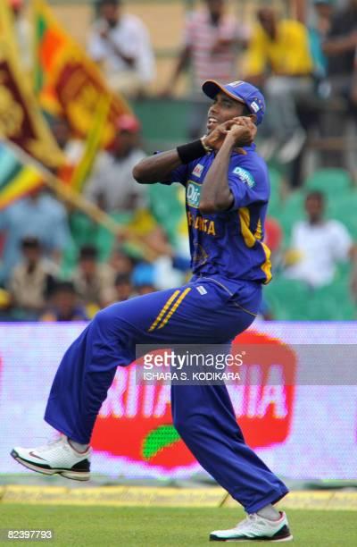 Sri Lankan cricketer Thilina Thushara Mirando take a catch to dismiss Indian batsman Zaheer Khan during the first One Day International match between...
