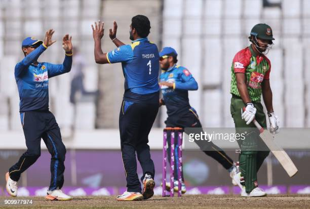 Sri Lankan cricketer Thisara Perera celebrates after the dismissal of Bangladeshi batsman Sabbir Rahman during the sixth One Day International match...