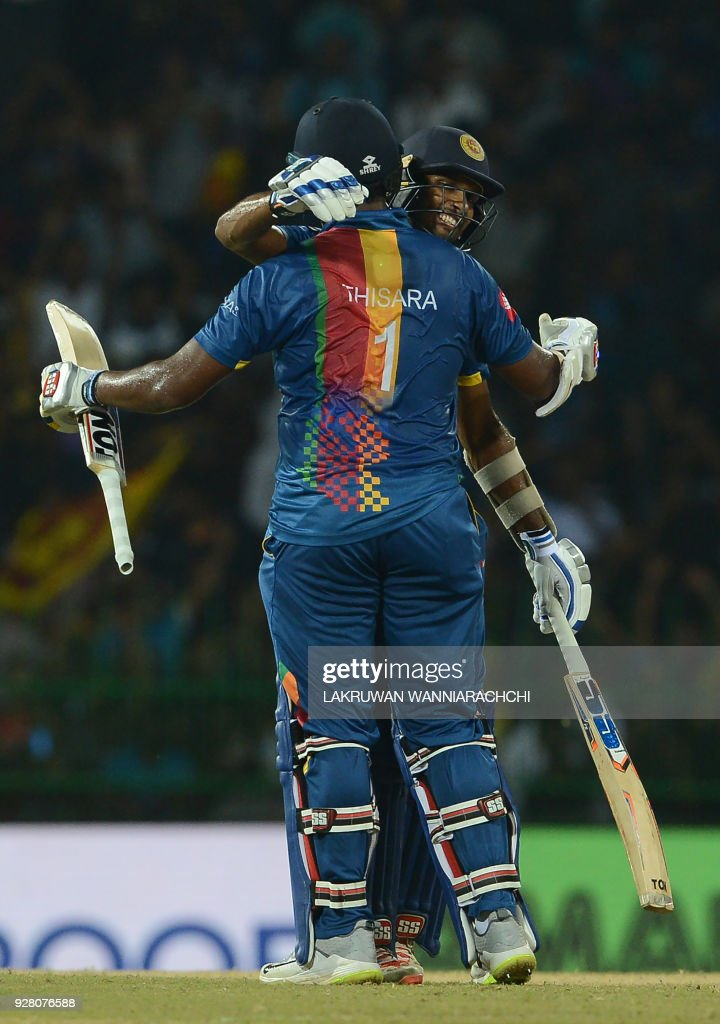 Sri Lankan cricketer Thisara Perera (L) celebrates with teammate Dasun Shanaka after victory in the opening Twenty20 international cricket match between Sri Lanka and India for the Nidahas Trophy tri-nation Twenty20 tournament at The R. Premadasa Stadium in Colombo on March 6, 2018. The Nidahas Trophy tri-nation Twenty20 tournament involving Sri Lanka, Bangladesh and India. /