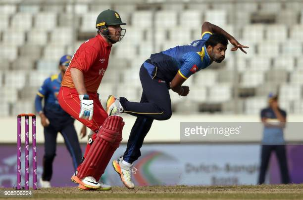 Sri Lankan cricketer Thisara Perera delivers a ball during the fourth One Day International cricket match in the TriNations Series between Sri Lanka...