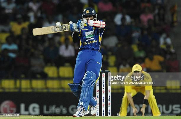 Sri Lankan cricketer Tillakaratne Dilshan plays a shot during the second Twenty20 match between Sri Lanka and Australia at The Pallekele...