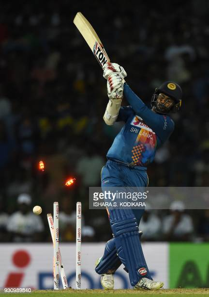 Sri Lankan cricketer Upul Tharanga is bowled by Indian bowler Vijay Shankar during the fourth Twenty20 international cricket match between India and...