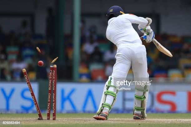 Sri Lankan cricketer Upul Tharanga is bowled out by Indian bowler Umesh Yadav during the 3rd Day's play in the 2nd Test match between Sri Lanka and...