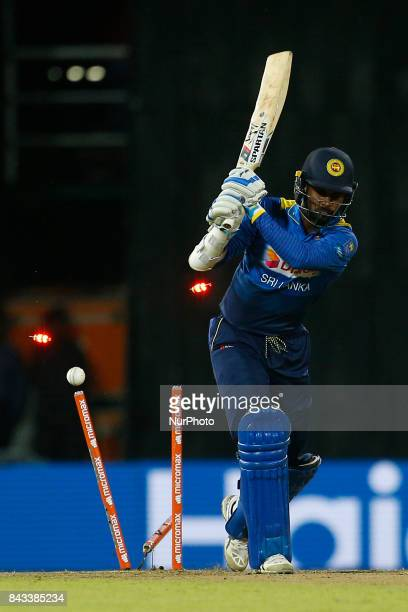 Sri Lankan cricketer Upul Tharanga is bowled out during the 1st and only T20 cricket match between Sri Lanka and India at R Premadasa International...