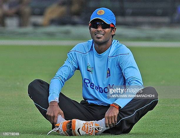 Sri Lankan cricketer Upul Tharanga warms up during a team practice session at The Pallekele Interntional Cricket Stadium in Pallekele on August 9...