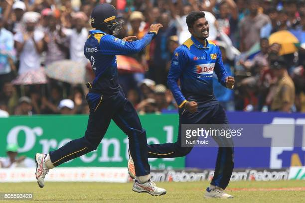 Sri Lankan cricketer Wanidu Hasaranga celebrates after he completed taking a hattrick of wickets against Zimbabwe during the 2nd One Day...
