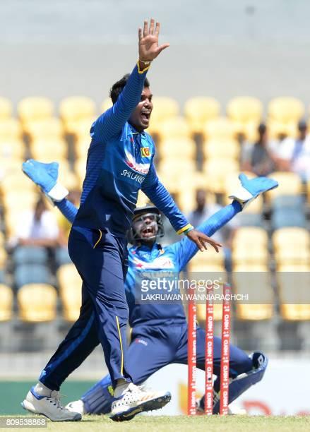 Sri Lankan cricketer Wanidu Hasaranga celebrates after he dismissed Zimbabwe cricketer Craig Ervine during the third oneday international cricket...