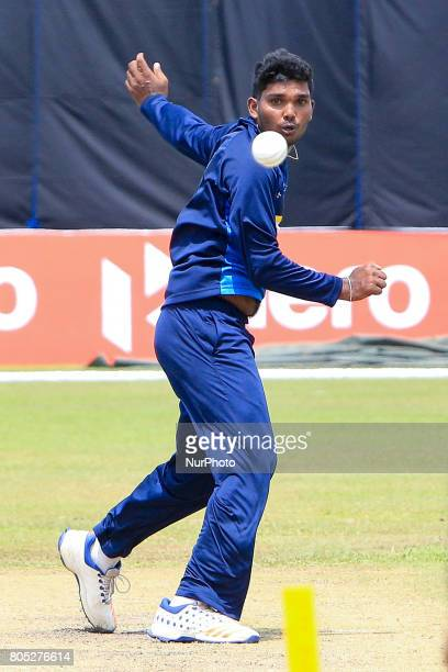 Sri Lankan cricketer Wanidu Hasaranga delivers a ball during a practice session ahead of the 2nd ODI cricket match between Sri Lanka and Zimbabwe at...