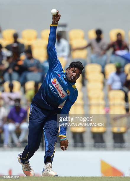 Sri Lankan cricketer Wanidu Hasaranga delivers a ball during the third oneday international cricket match between Sri Lanka and Zimbabwe at the...