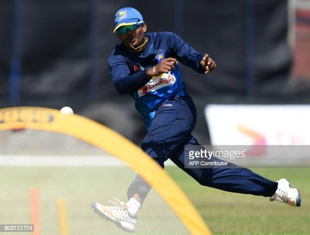 Sri Lankan cricketer Wanidu Hasaranga takes part in a practice session at Galle International Cricket Stadium in Galle on June 29 ahead of the first...