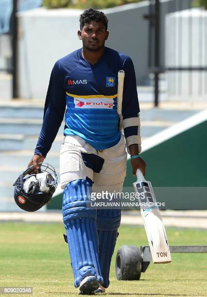 Sri Lankan cricketer Wanidu Hasaranga walks with his equipment during a practice session ahead of the third oneday international against Zimbabwe at...