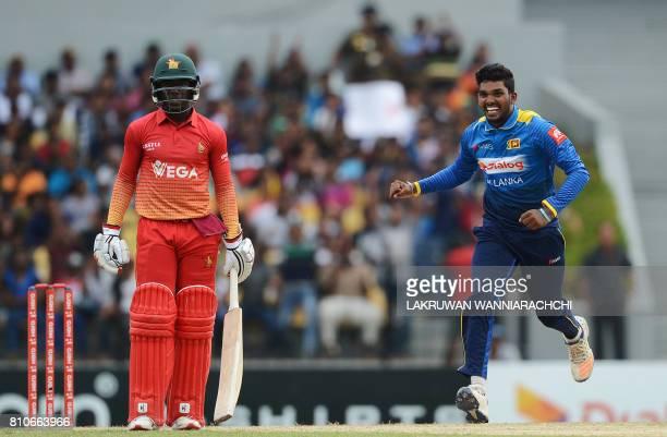 Sri Lankan cricketer Wanindu Hasaranga celebrates after he dismissed Zimbabwe's cricketer Solomon Mire during the fourth oneday international cricket...