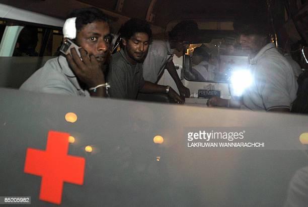 Sri Lankan cricketers Ajantha Mendis Kumar Sangakkara Suranga Lakmal and Tharanga Paranavithana get into an ambulance shortly after returning to the...