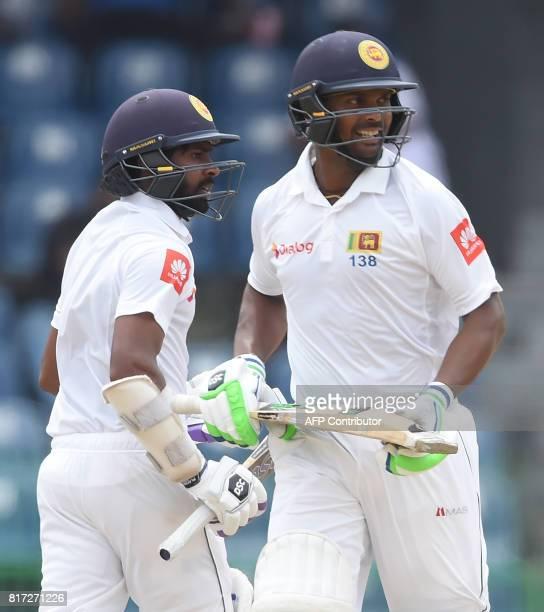 Sri Lankan cricketers Asela Gunaratne and Niroshan Dickwella run between the wickets during the final day of a oneoff Test match between Sri Lanka...