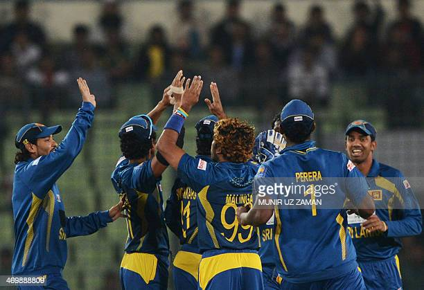 Sri Lankan cricketers celebrate after the dismissal of Bangladesh batsman Anamul Haque during the first OneDay International cricket match between...
