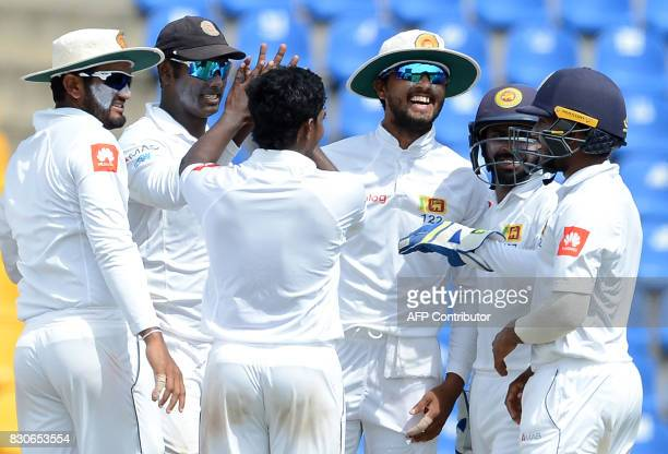 Sri Lankan cricketers celebrates after the dismissal of Indian cricketer Cheteshwar Pujara during the first day of the third and final Test match...