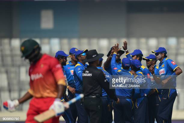 Sri Lankan cricketers celebrates after the dismissal of Zimbabwe cricketer Solomon Mire during the second One Day International cricket match in the...