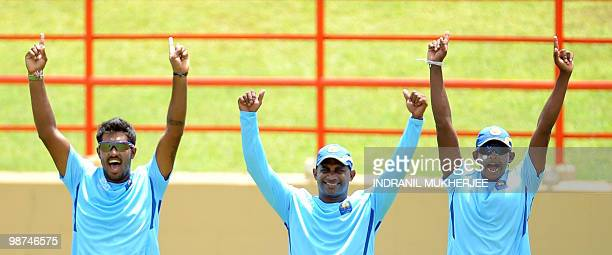 Sri Lankan cricketers Chamara Kapugedara, Sanath Jaysuriya and Ajntha Medis exult after winning a point in a game during a training session at the...