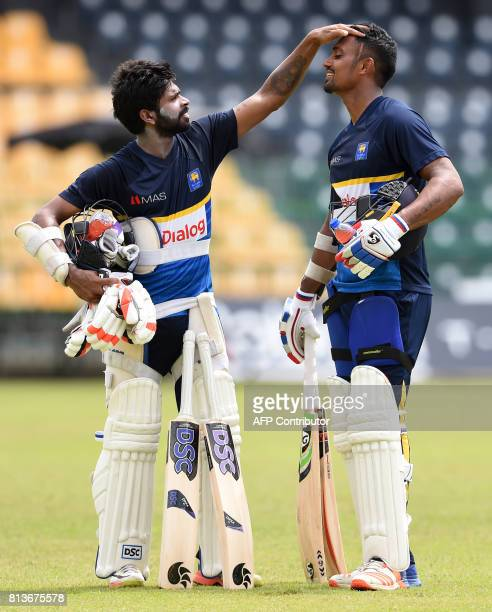 Sri Lankan cricketers Niroshan Dickwella and teammate Danushka Gunathilaka takes part in a practice session at the R Premadasa Cricket Stadium in...
