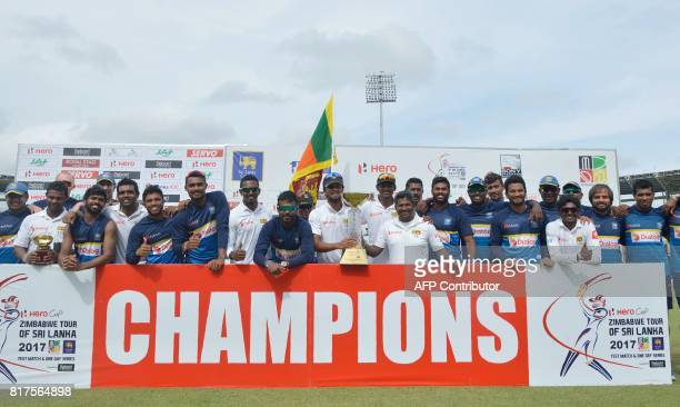 Sri Lankan cricketers pose for photographers after victory in the final day of a oneoff Test match between Sri Lanka and Zimbabwe at the R Premadasa...
