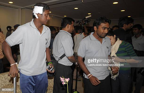 Sri Lankan cricketes Ajantha Mendis and captain Mahela Jayawardene arrive in Colombo on March 4 2009 after escaping a terrorist attack in an ambush...