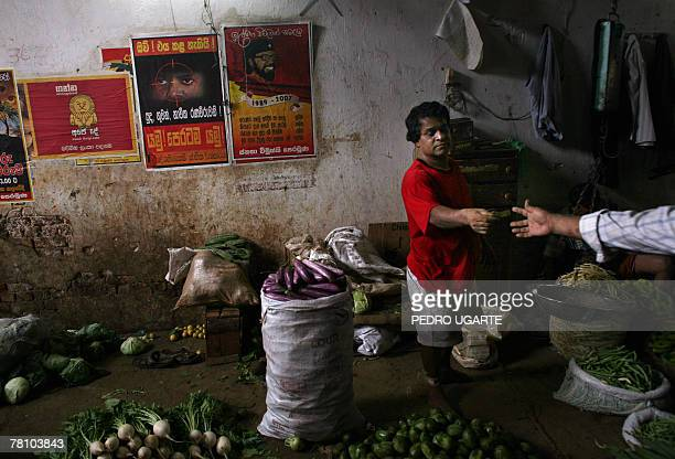 A Sri Lankan customer buys vegetables in a street market of Colombo 27 November 2007 The island is set for another year of conflict with the...