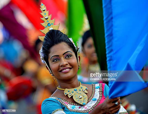 A Sri Lankan dancer participates in a progovernment May Day rally in Colombo on May 1 2014 Sri Lankan workers are marking International Labour Day...