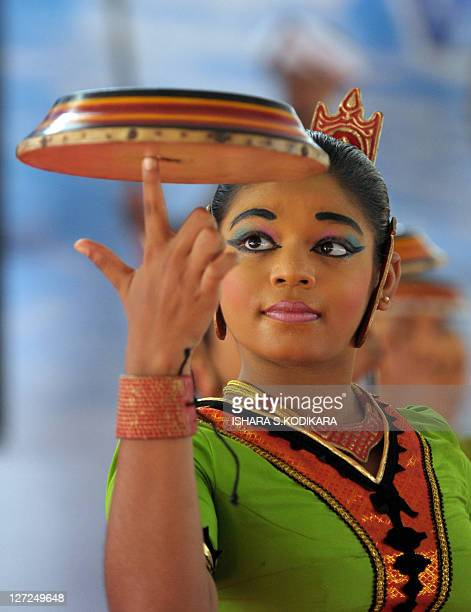A Sri Lankan dancer swirls a hand drum during a ceremony to mark World Tourism Day in Colombo on September 27 2011 Sri Lanka hopes to attract some...