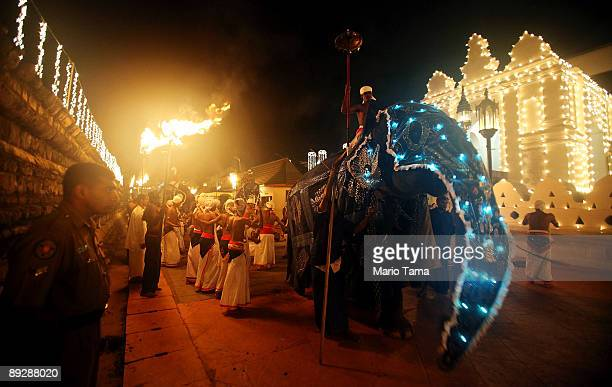 Sri Lankan dancers and an elephant perform on opening night of the annual Kandy Esala Perahera festival occuring for the first time since the end of...
