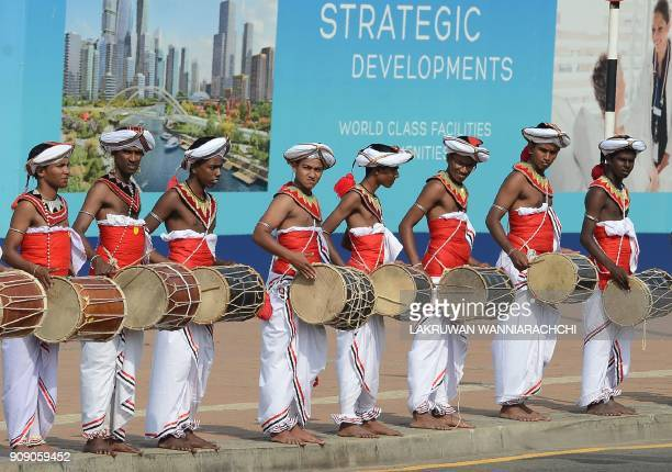 Sri Lankan dancers perform a traditional dance during a welcome ceremony for Singapore Prime Minister Lee Hsien Loong in Colombo on January 23 2018...