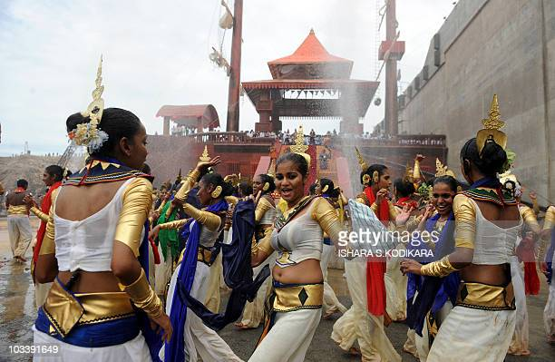 Sri Lankan dancers perform at the site of A new port under construction at the southern town of Hambantota on August 15 Sri Lanka President Mahinda...