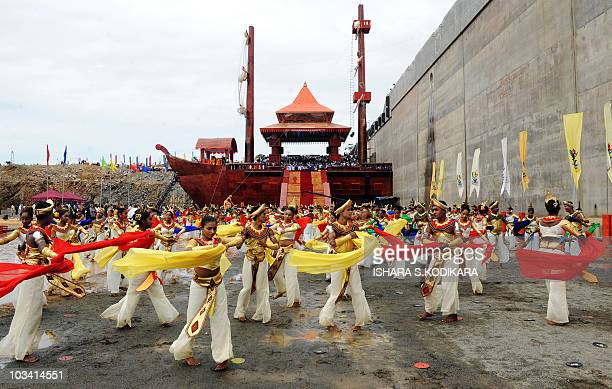 Sri Lankan dancers perform at the site of a new port under construction at the southern town of Hambantota on August 15 2010 Sri Lanka President...