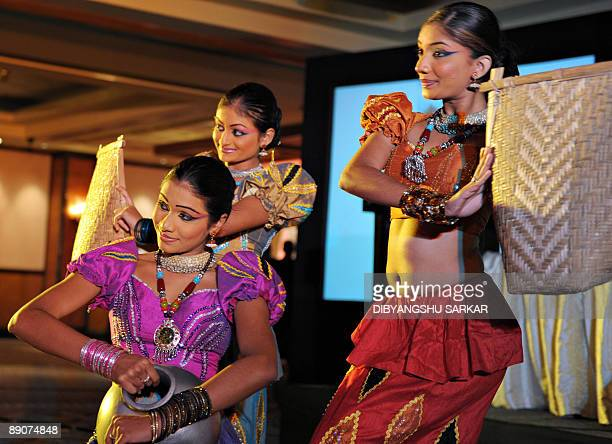 Sri Lankan dancers perform during an event to promote their country's tourism industry in Bangalore on July 17 2009 The tourism event was organised...
