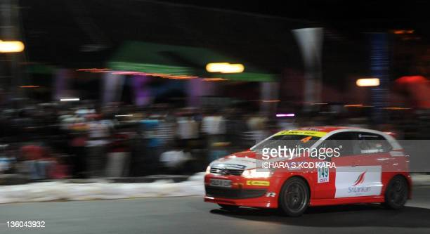 Sri Lankan drivers take part in the island's first night street races in Colombo on December 17, 2011. The races took drivers through the scenic...