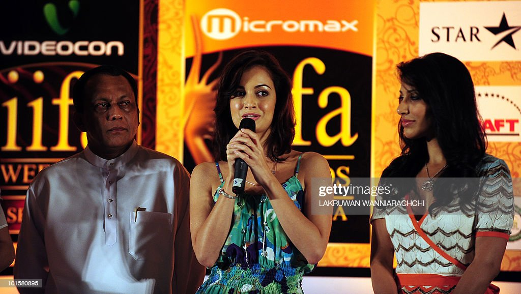 Sri Lankan Economic Development Deputy Minister Lakshman Yapa Abeywardena and Bollywood actresses Dia Mirza and Sophie Choudhury hold a news conference for the International Indian Film Academy (IIFA) awards in Colombo on June 3, 2010. Bollywood actors are in Sri Lanka to attend the three-day International Indian Film Academy (IIFA) awards that begins in Colombo on Thursday. AFP PHOTO/ Lakruwan WANNIARACHCHI.