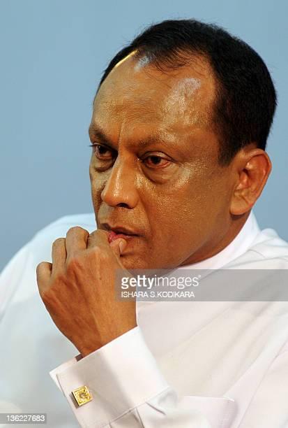 Sri Lankan Economic Development Deputy Minister Lakshman Yapa Abeywardena speaks at a press conference in Colombo on December 29, 2011. Sri Lanka's...