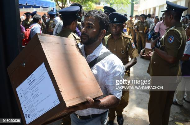 Sri Lankan election workers carry ballot boxes before boarding on buses as they prepare to go to their polling centres in Colombo February 9 2018 Sri...