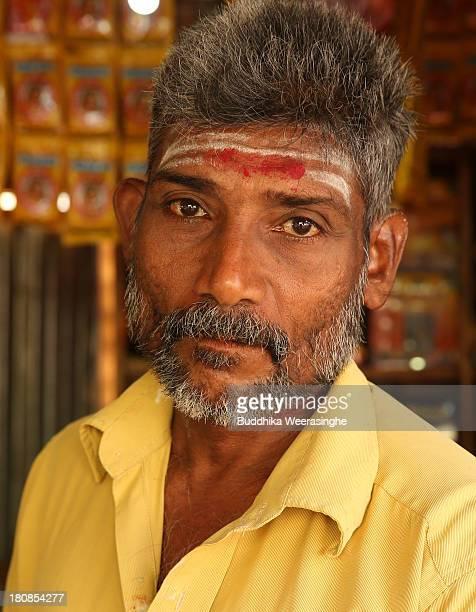 Sri Lankan ethnic Tamil betel vendor looks on at the former rebel capital of Kilinochchi on September 16 2013 in Kilinochchi Sri Lanka Sri Lanka is...