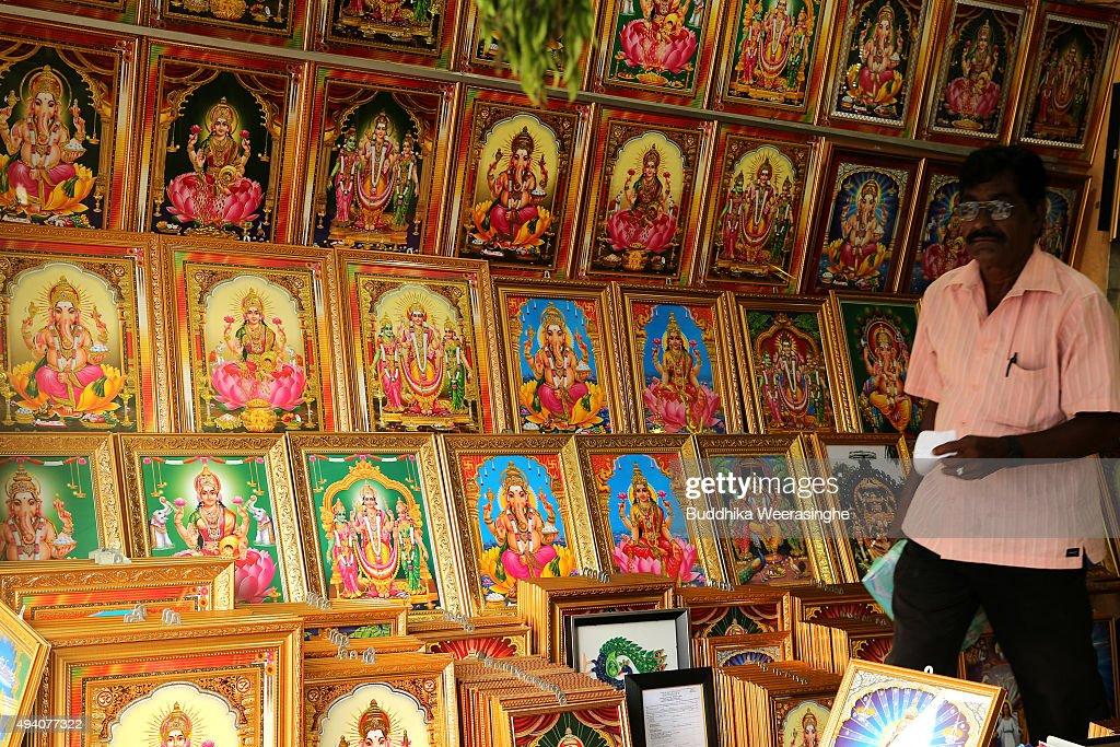 A Sri Lankan ethnic Tamil customer walks inside the Hindu