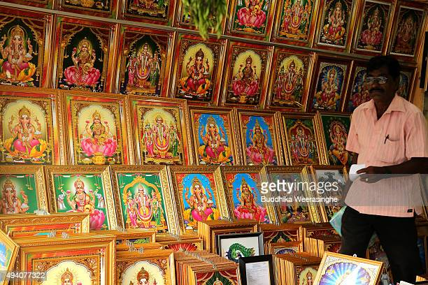 Sri Lankan ethnic Tamil customer walks inside the Hindu gods photo selling shop on October 24 2015 in Jaffna Sri Lanka Sri Lankan Prime Minister...