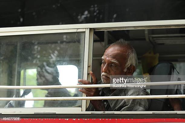 Sri Lankan ethnic Tamil man looks out from bus window on October 24 2015 in Jaffna Sri Lanka Sri Lankan Prime Minister Ranil Wickremesinghe seeks...