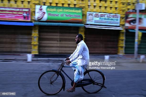Sri Lankan ethnic Tamil man rides bycycle in a street on October 24 2015 in Jaffna Sri Lanka Sri Lankan Prime Minister Ranil Wickremesinghe seeks...