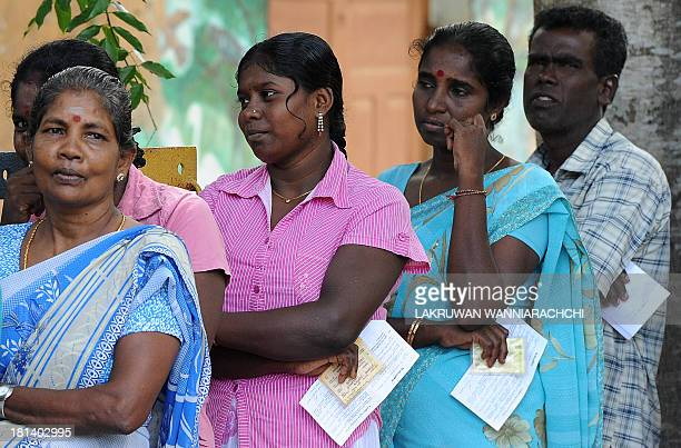 Sri Lankan ethnic Tamils wait in line to cast their votes at a polling station during the northern provincial council election in Jaffna 400...